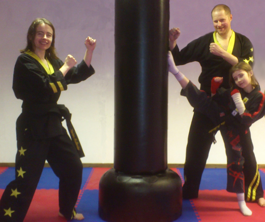 Pete, Marian and daughter at black belt grading