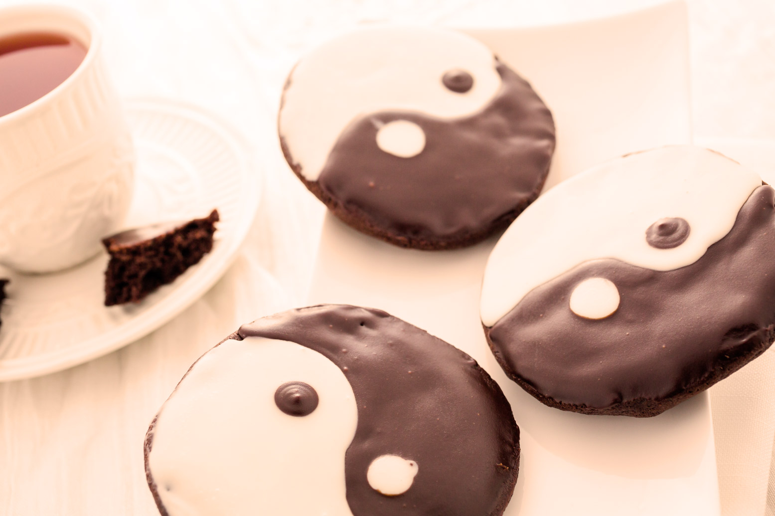Cookies with Yin Yang Icing and a Cup of Tea